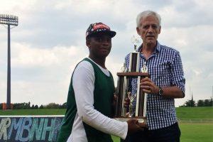 Winner posing with trophy