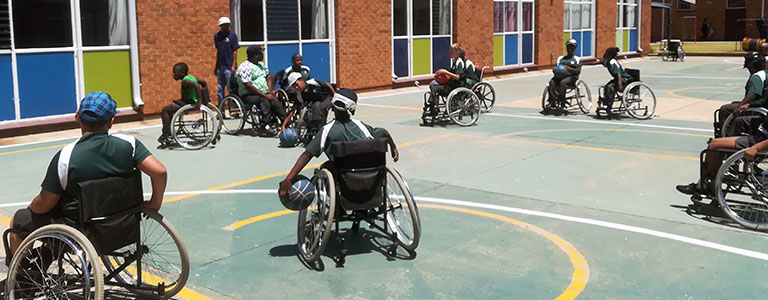 Wheelchair basketball players on the court