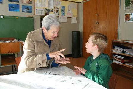 Speech therapist instructing pupil